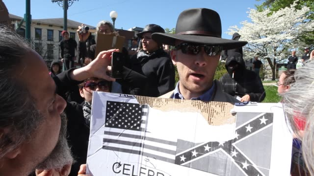 Thomas Buhls a member of the Ku Klux Klan KKK stages a one man rally at the Monroe County Courthouse by holding a sign with an American and a...