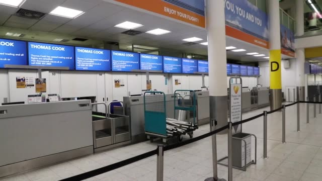 thomas cook checkin desks stand empty at gatwick airport after the travel giant collapsed the uk's largest peacetime repatriation has been launched... - peacetime stock videos & royalty-free footage