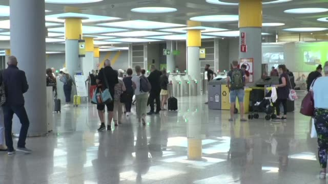 thomas cook passengers at palma airport face an uncertain wait for a flight back to britain following the collapse of the travel giant - majorca stock videos & royalty-free footage