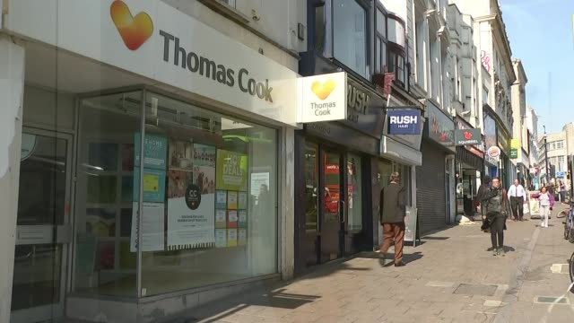 thomas cook reports 1.5 billion pound losses; england: sussex: brighton: ext gv thomas cook travel agent on high street close shot of thomas cook... - street name sign stock videos & royalty-free footage