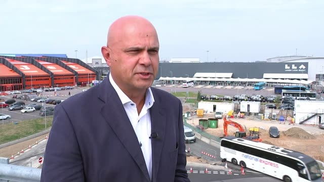 thomas cook travel agency relaunches as prices fall; england: bedfordshire: luton: luton airport: ext alan french interview sot. cutaway itn reporter... - luton airport stock videos & royalty-free footage