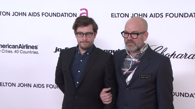 Thomas Dozol Michael Stipe at the 19th Annual Elton John AIDS Foundation Academy Awards Viewing Party at West Hollywood CA