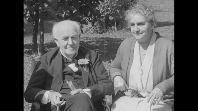 vídeos y material grabado en eventos de stock de ms thomas edison and wife mina sitting outside man brings something for mina to sign she writes on pad as her husband watches - fort myer