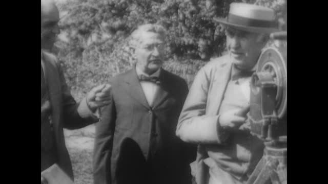 Thomas Edison films Henry Ford as they recreate the first motion picture
