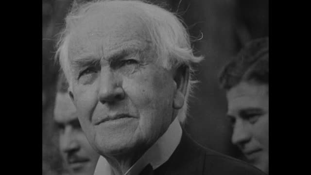 CU Thomas Edison in his later years / Edison stands with back facing camera as he listens to President Herbert Hoover at the 'Light's Golden Jubilee'...