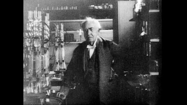 / thomas edison posing in front of lab equipment thomas edison in his laboratory on january 01 1920 - 発明家点の映像素材/bロール