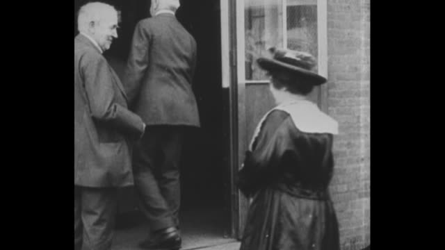 ms thomas edison shakes hands with various people as they enter building / ms edison stands with young woman in doorway / still photo of edison with... - certificate stock videos & royalty-free footage