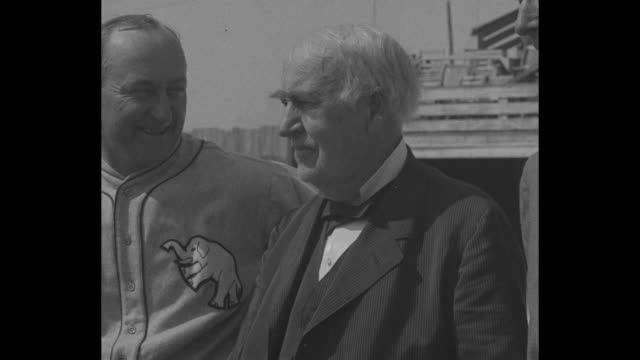 thomas edison standing between baseball player ty cobb at left and philadelphia athletics' owner and manager connie mack / edison and cobb talking to... - baseball bat stock videos & royalty-free footage
