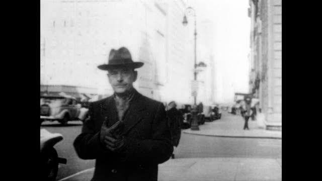 / thomas mann putting on gloves as he walks down a city street. thomas mann walking down street on january 01, 1940 in unspecified - nobel prize in literature stock videos & royalty-free footage