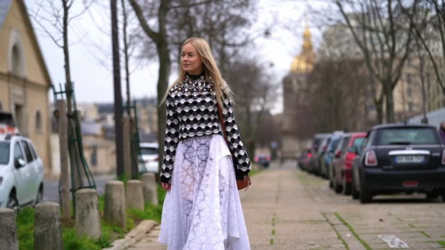 thora valdimars wears a black and white bejeweled top with geometric patterns, a white lace mesh skirt, black leather boots, outside loewe, during... - mesh textile stock videos & royalty-free footage