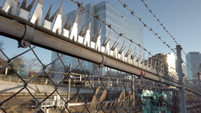 thorn fence and city - prison break stock videos & royalty-free footage