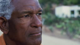 Thoughtful African American Senior Man Outdoors In Countryside