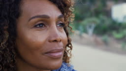 Thoughtful African American Senior Woman Outdoors In Countryside