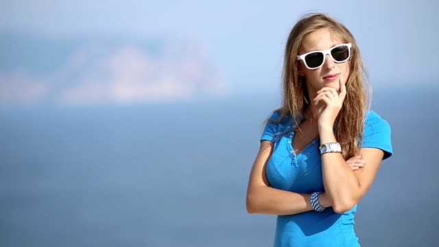 thoughtful girl on a beautiful coast - fine art portrait stock videos & royalty-free footage