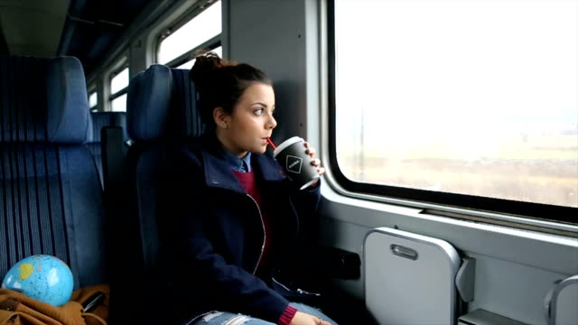 thoughtful girl riding on a train - bag stock videos & royalty-free footage
