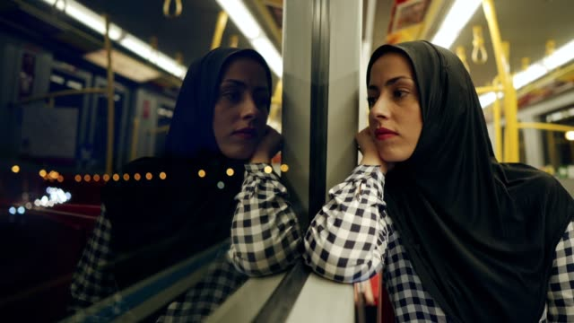 thoughtful muslim woman in the train - refugee stock videos & royalty-free footage