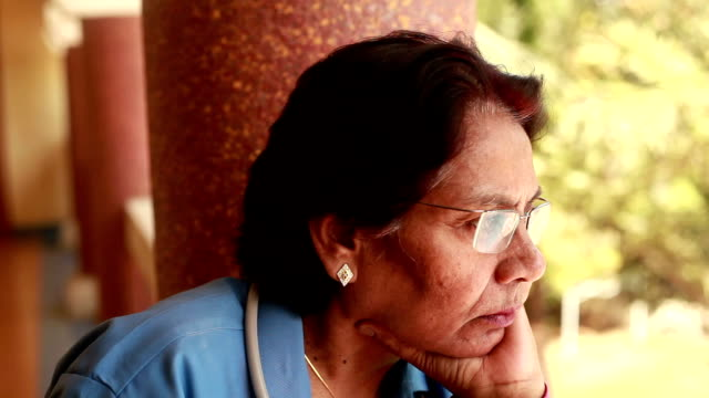 thoughtful pensive senior indian woman doctor - indian culture stock videos & royalty-free footage