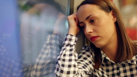 thoughtful woman in the train - worried stock videos & royalty-free footage
