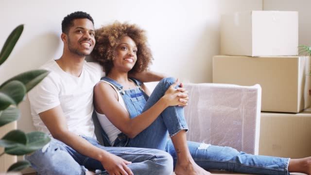 thoughtful young couple relaxing against wall - young couple stock videos & royalty-free footage
