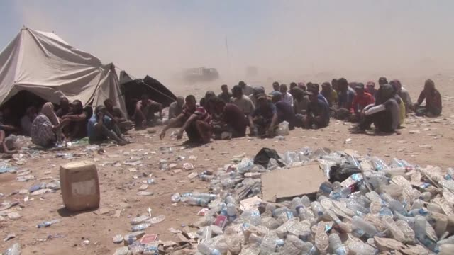 thousand of iraqi civilians flee fighting between islamic state group jihadists and iraqi security forces backed by shiite militia of the popular... - shi'ite islam stock videos & royalty-free footage