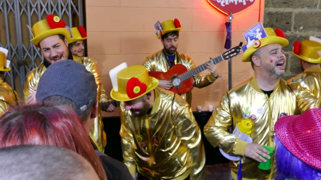 thousands arrive to cadiz for the annual carnival celebration said to be the world's second largest only to that in rio unique to cadiz hundreds of... - historische kleidung traditionelle kleidung stock-videos und b-roll-filmmaterial