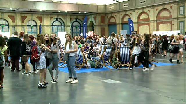 "thousands attend youtube ""summer in the city"" convention; england: london: alexandra palace: int emma blackery posing for photograph with fan at... - itv london tonight weekend stock videos & royalty-free footage"