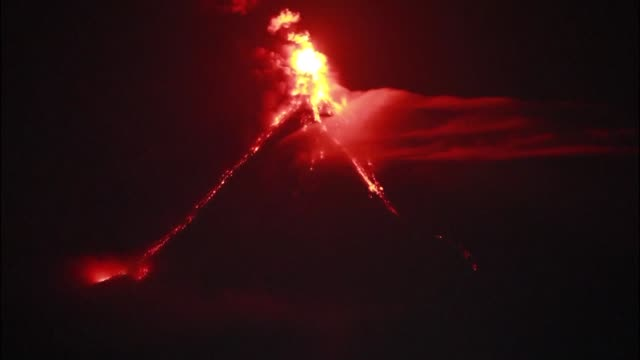 Thousands flee from their homes as lava oozed out of a rumbling Philippine volcano in what volcanologists described as a quiet eruption warning it...