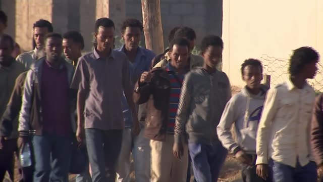 thousands flee oppressive regime to europe ethiopia maiaini refugee camp ext various of long line of eritrean refugees along after crossing the border - ethiopia stock videos & royalty-free footage