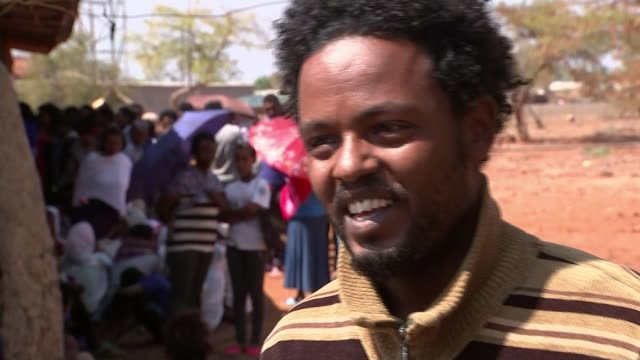 thousands flee oppressive regime to europe ethiopia maiaini refugee camp ext eritrean refugees gathered outside building reporter talkign to eritrean... - ethiopia stock videos & royalty-free footage