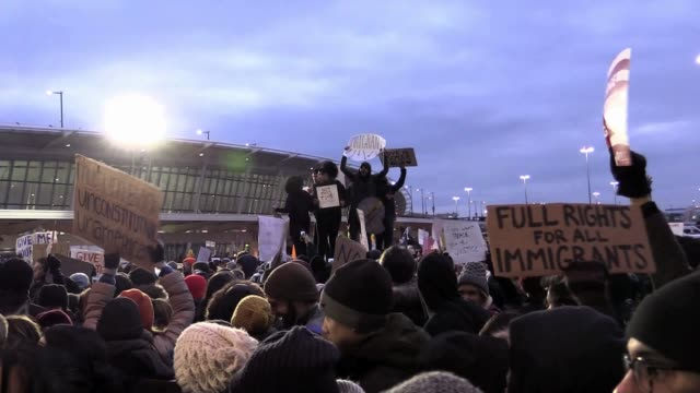 thousands gather at jfk airport terminal 4 to protest trump travel ban. travelers detained inside airport - forbidden stock videos & royalty-free footage