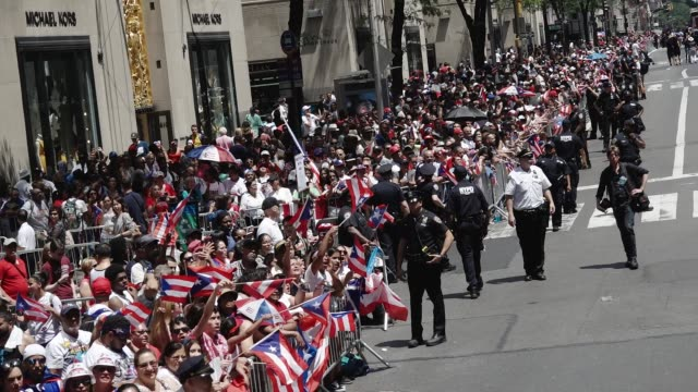 2017 thousands gather on 5th avenue for the 60th annual puerto rican day parade in manhattan new york city usa - プエルトリコ人点の映像素材/bロール