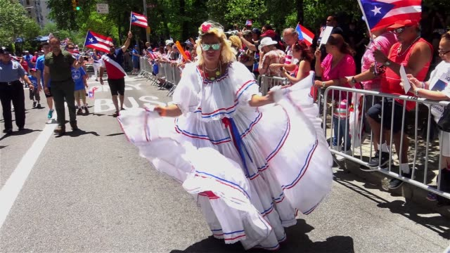 Thousands gather on 5th Avenue for the Puerto Rican Day Parade / Manhattan 5th Avenue New York City USA