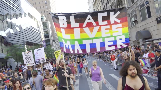 stockvideo's en b-roll-footage met thousands gathered for the 49th annual new york city lgbt pride march in manhattan on sunday june 24 2018 via the west village and 5th avenue... - black lives matter