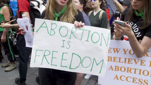 thousands gathered for the focus on the family event in times square on saturday may 4, 2019 for an anti-abortion pro-life event in times square new... - abortion stock videos & royalty-free footage