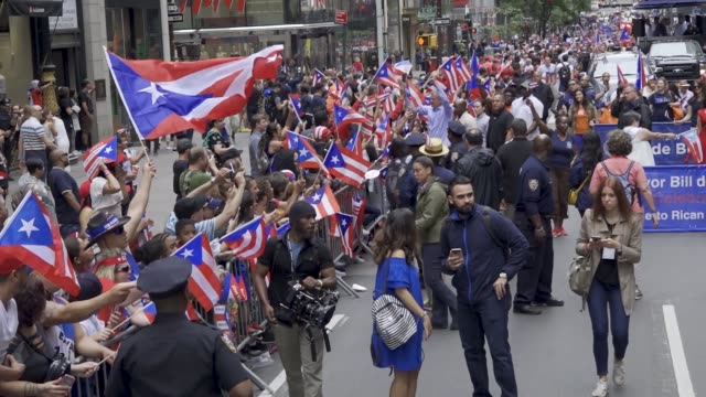 thousands gathered on 5th avenue for the 61th annual puerto rican day parade in manhattan, new york city, usa #prparade . . - ビル・デ・ブラシオ点の映像素材/bロール