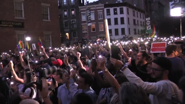 thousands jam streets at stonewall inn for reading of 49 victims names at candlelight vigil - candlelight stock videos & royalty-free footage