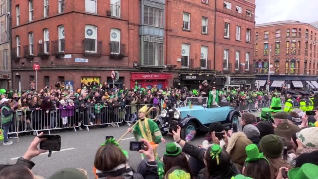 thousands line the street of dublin to watch the annual st patrick's day parade. - st. patrick's day stock videos & royalty-free footage