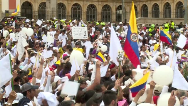 Thousands march alongside President Ivan Duque and other Colombian leaders to repudiate violence and terrorism following the bombing of a police...