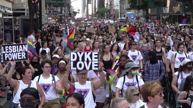 thousands march down fifth avenue with signs 'dyke love', 'lesbian power', during the 29th annual dyke march celebrating lgbtq pride on june 26 in... - azul stock videos & royalty-free footage