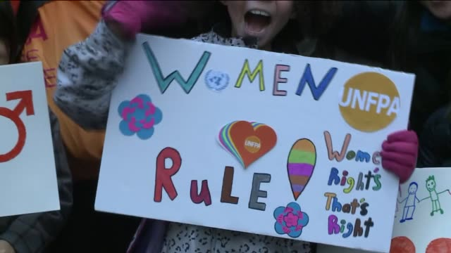 thousands march from the united nations to times square for gender equality on international women's day - internationaler frauentag stock-videos und b-roll-filmmaterial