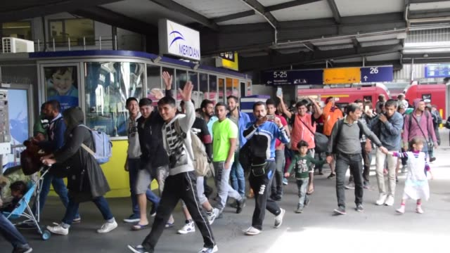 Thousands more migrants streamed into Germany Sunday greeted with cheers and 'welcome' signs as Pope Francis called on every Catholic parish in...