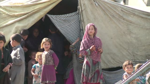 thousands of afghan refugees became unwanted in pakistan after a taliban massacre at a peshawar school, forcing them to return home to a life of... - peshawar stock videos & royalty-free footage