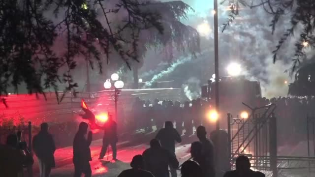 thousands of albanians protest against prime minister edi rama throwing firecrackers and lighting flares at a rally in tirana - throwing stock videos & royalty-free footage