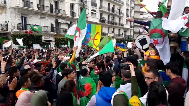 thousands of algerians stage a demonstrations in capital algiers on april 19 2019 to demand the departure of all officials affiliated with the regime... - アルジェリア点の映像素材/bロール