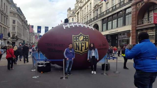 Thousands of American football fans descend on central London ahead of the NFL game between the New Orleans Saints and Miami Dolphins at Wembley on...