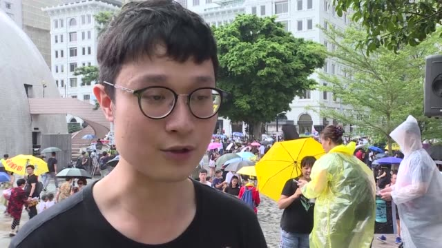 thousands of antigovernment protesters began a march in hong kong sunday that will end outside a controversial train station linking the territory to... - vox populi stock videos and b-roll footage
