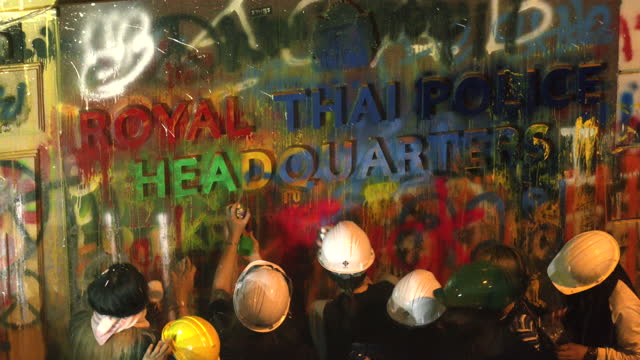 thousands of antigovernment protesters gather at ratchaprasong intersection then at bangkok police headquarters to throw paint on the entrance after... - thailand stock videos & royalty-free footage