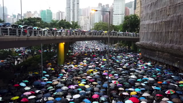 thousands of antigovernment protesters march on a street after leaving a rally in victoria park on august 18 2019 in hong kong china prodemocracy... - large group of people stock videos & royalty-free footage