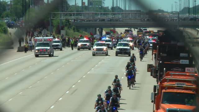 WGN Thousands of antiviolence protesters marched along a Chicago's Dan Ryan Expressway on July 7 shutting down traffic to draw attention to the gun...