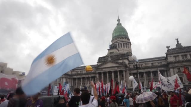 thousands of argentine unions and activists protest against the president mauricio macri's austerity plan - mauricio macri stock videos and b-roll footage